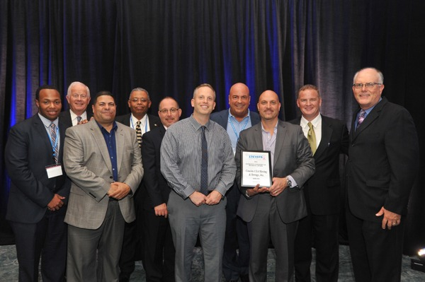 Cousins USA owners and staff with achievement awards