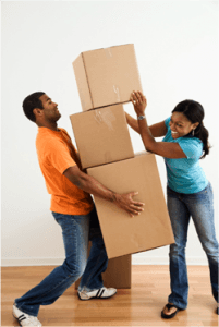 Couple carrying and stacking moving boxes