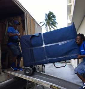 Cousins USA movers handling padded furniture