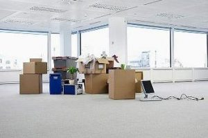empty office space with moving boxes
