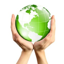 hands holding green and white globe