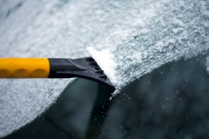 Scraping_ice_off_windshield
