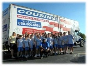 Cousins USA movers in front of a truck