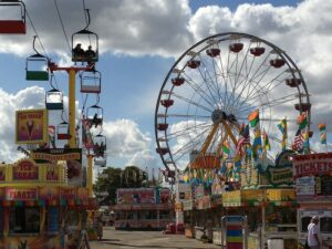 a ferris wheel and other carnival rides