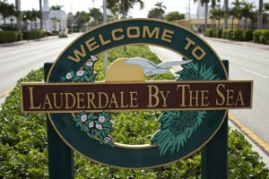 "Sign says, ""Welcome to Lauderdale By The Sea"""
